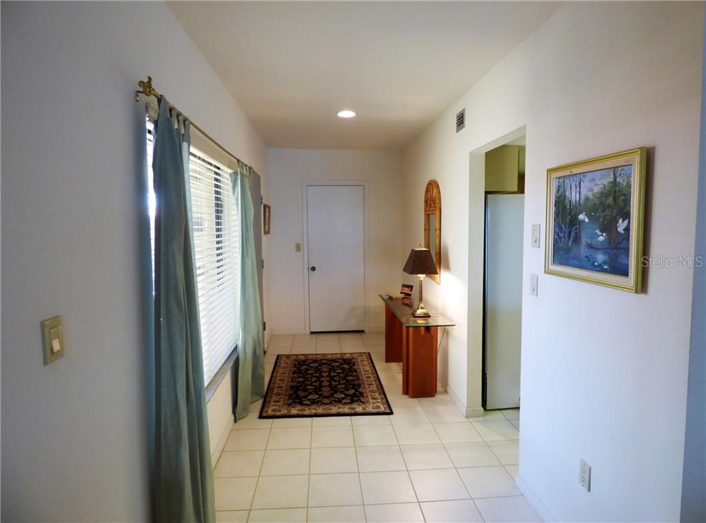 Sunny foyer, HUGE pantry closet at rear, kitchen to right - Condo for sale at 3280 Southshore Dr #86c, Punta Gorda, FL 33955 - MLS Number is C7413505