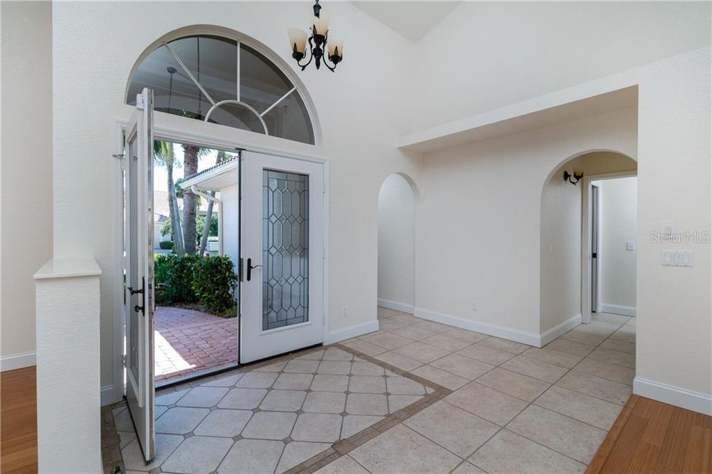 Brick Paver walk way leads to the beautiful accented Tile Entry. - Single Family Home for sale at 1309 Casey Key Dr, Punta Gorda, FL 33950 - MLS Number is C7413790