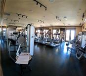 Cybex training machines including treadmills, elliptical, weighted pulley machines and free weights. - Condo for sale at 98 Vivante Blvd #9828, Punta Gorda, FL 33950 - MLS Number is C7242665