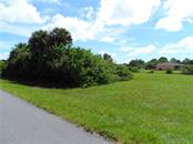 Another picture of the lot to the left - Vacant Land for sale at 119 Rifle Rd, Rotonda West, FL 33947 - MLS Number is C7406393