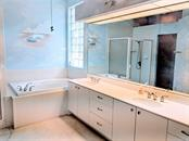 MASTER BATH WITH DOUBLE SINKS - Single Family Home for sale at 26442 Feathersound Dr, Punta Gorda, FL 33955 - MLS Number is C7412660