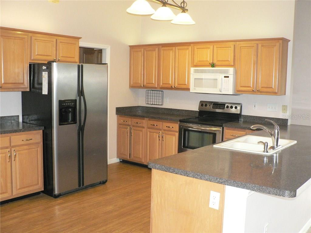 Lots Of Counter Space And Cabinets   Single Family Home For Sale At 16416  Golf Course