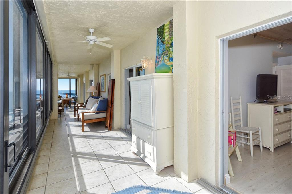 Looking straight down the balcony. Bedrooms are on the right. - Condo for sale at 1100 Benjamin Franklin Dr #804, Sarasota, FL 34236 - MLS Number is A4172174
