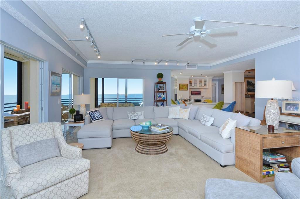 Living Room facing West and South. - Condo for sale at 1100 Benjamin Franklin Dr #804, Sarasota, FL 34236 - MLS Number is A4172174
