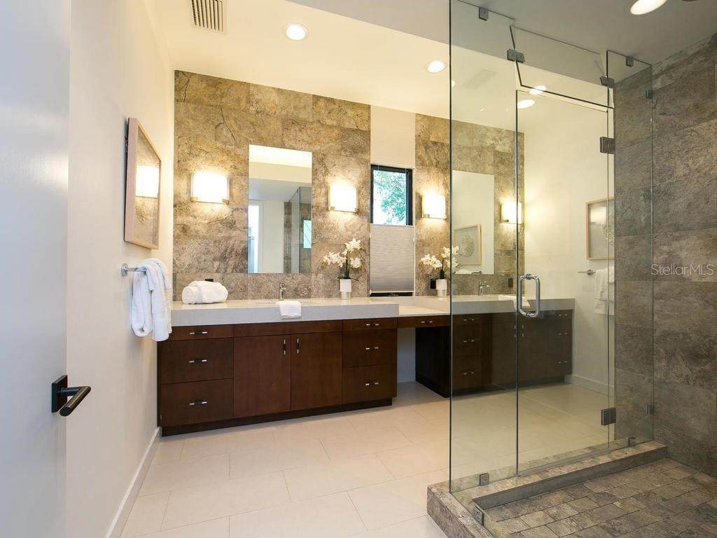 Stunning master suite bath includes a rejuvenating steam rain shower and walk-in closet. - Single Family Home for sale at 2315 Mietaw Dr, Sarasota, FL 34239 - MLS Number is A4191514