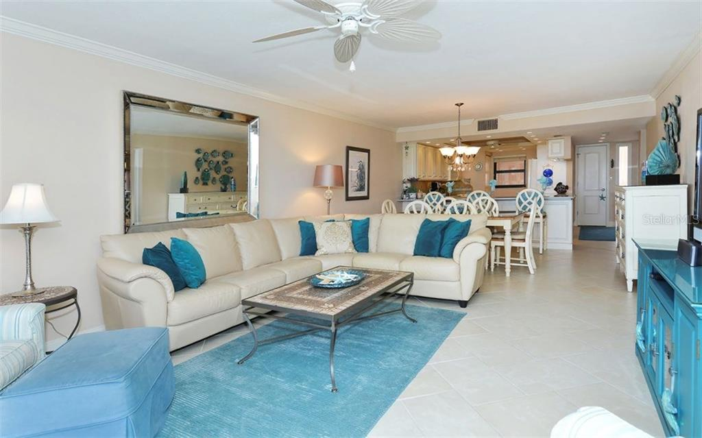 Living room with sliders to balcony with full Gulf views - Condo for sale at 6480 Midnight Pass Rd #217, Sarasota, FL 34242 - MLS Number is A4202790