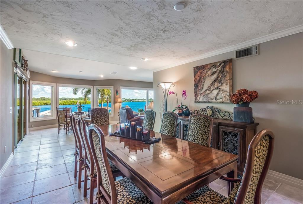 Formal dining area with plenty of room to entertain - Single Family Home for sale at 1253 Riegels Landing Dr, Sarasota, FL 34242 - MLS Number is A4203768