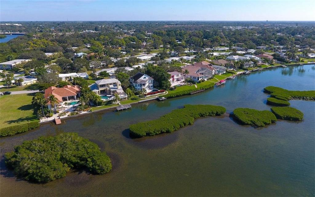 Perfectly trimmed mangroves offers you a fabulous view! Imagine fishing from your dock and cooking your catch right on the grill!  Now that's fresh!! - Single Family Home for sale at 5824 Tidewood Ave, Sarasota, FL 34231 - MLS Number is A4205461