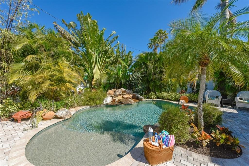 Heated lagoon style pool with rock waterfall. - Single Family Home for sale at 306 Gulf Blvd, Anna Maria, FL 34216 - MLS Number is A4206962