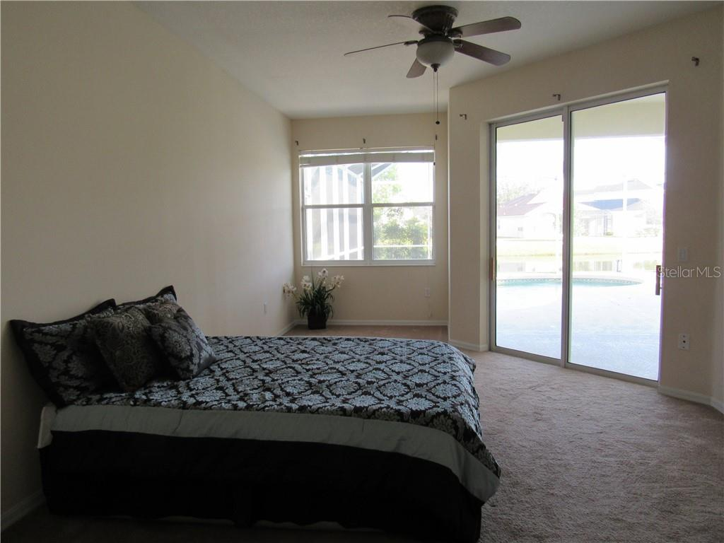 Master Bedroom with Lake View, sliding glass doors to lanai - Single Family Home for sale at 13336 Purple Finch Cir, Lakewood Ranch, FL 34202 - MLS Number is A4405444
