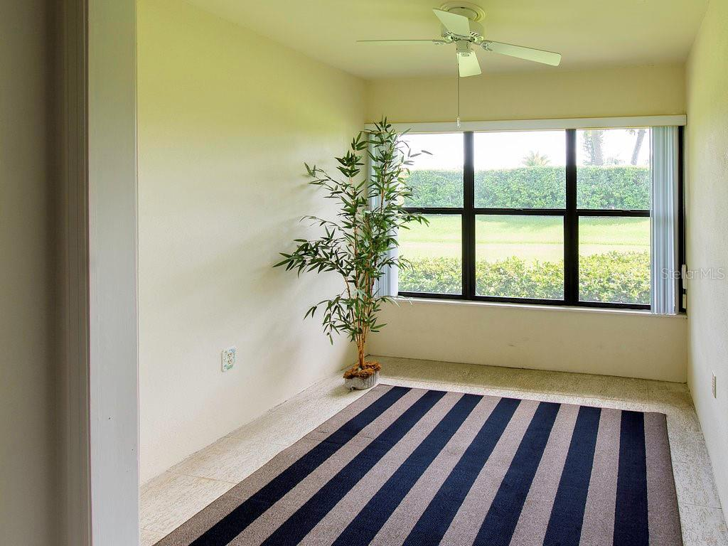 Enclosed lanai in master bedroom for additional apace. Can be used as a sitting room or office - Villa for sale at 7467 Carnoustie Dr #5d, Sarasota, FL 34238 - MLS Number is A4412518