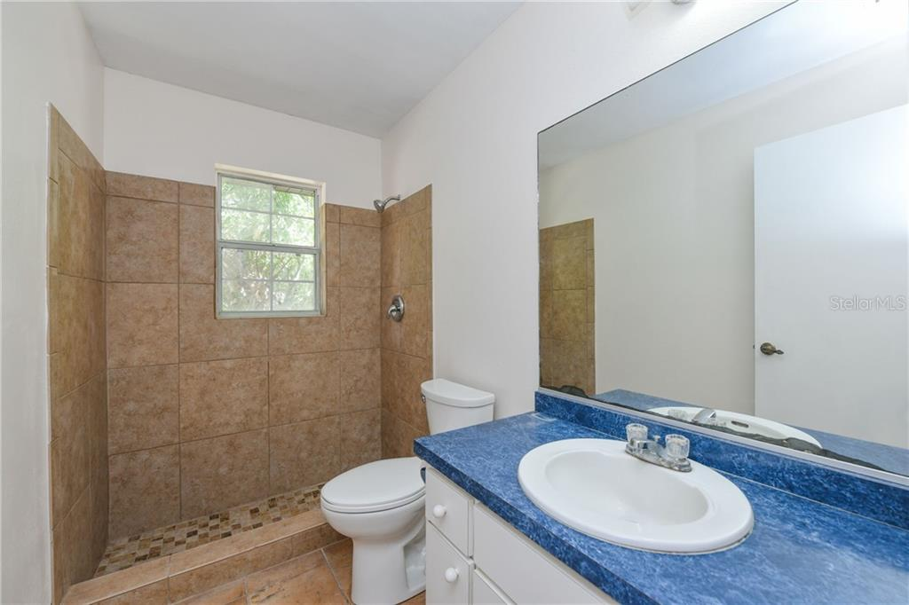 Second bath, new shower enclosure. - Single Family Home for sale at 2045 Frederick Dr, Venice, FL 34292 - MLS Number is A4416740