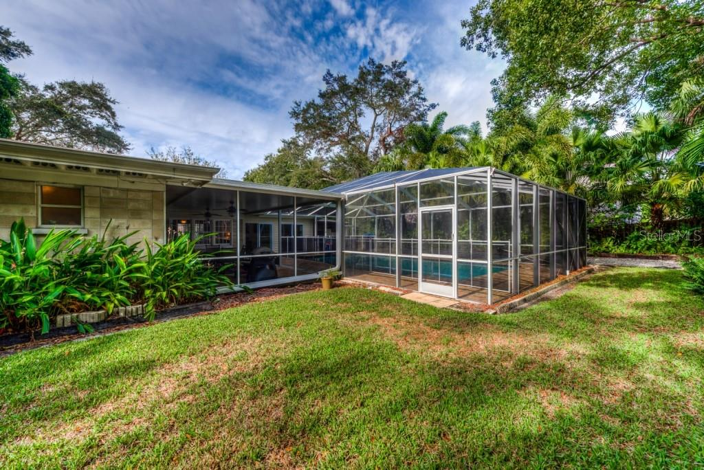 The rear yard has lots of room to run and play. You'll love the privacy and beauty the mature landscaping adds to this over-sized 100 x 150 home site. - Single Family Home for sale at 1509 Flower Dr, Sarasota, FL 34239 - MLS Number is A4421898