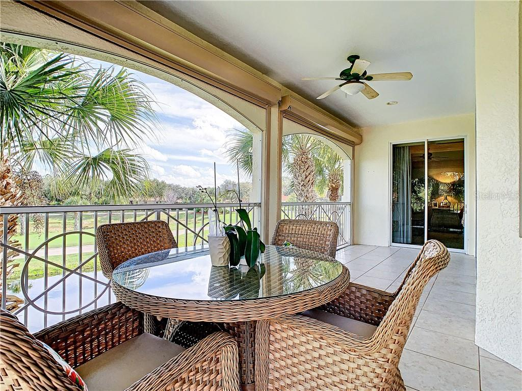 Tiled and screened lanai - including roll down hurricane shutters. - Condo for sale at 9453 Discovery Ter #201c, Bradenton, FL 34212 - MLS Number is A4423314