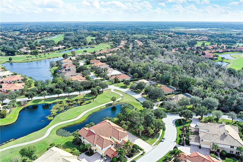 Overhead View - golf/water views!  End unit with lush preserve to the side. - Condo for sale at 9453 Discovery Ter #201c, Bradenton, FL 34212 - MLS Number is A4423314