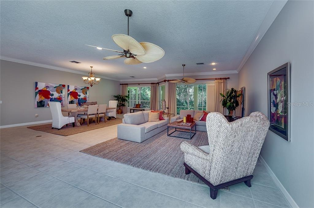 Combination great room/dining room with large windows to let in wonderful light. - Single Family Home for sale at 2972 Jeff Myers Cir, Sarasota, FL 34240 - MLS Number is A4424133