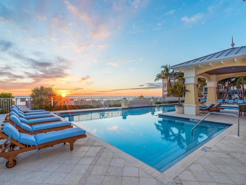 View of sunset from pool - Orchid Beach Club. - Condo for sale at 2050 Benjamin Franklin Dr #a702, Sarasota, FL 34236 - MLS Number is A4424335