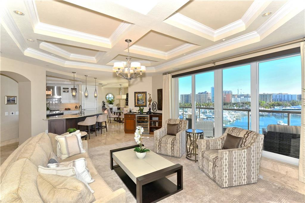 Open floor plan with Grand Salon, Kitchen and Dining Room.  Wet bar on the left hand side of Salon. - Condo for sale at 464 Golden Gate Pt #702, Sarasota, FL 34236 - MLS Number is A4424493