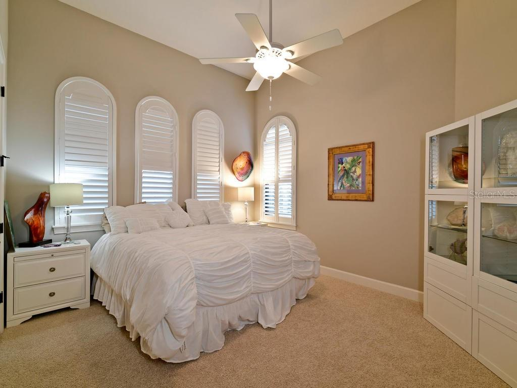 I absolutely love this 3rd bedroom, King sized bed has plenty of room as you can see. Stylish windows complete with plantation shutters! Private bathroom as well! - Single Family Home for sale at 13707 Palazzo Ter, Bradenton, FL 34211 - MLS Number is A4427731