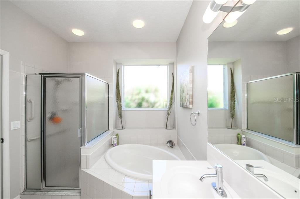 Master Bath, large tub and walk-in shower. - Single Family Home for sale at 702 Anna Hope Ln, Osprey, FL 34229 - MLS Number is A4427993
