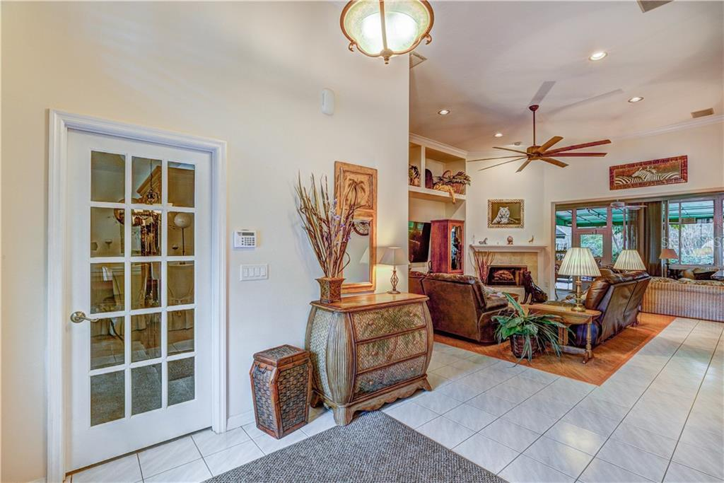 Fantastic open entry way with study on left, great room straight on, and dining to the right - Single Family Home for sale at 6321 W Glen Abbey Ln E, Bradenton, FL 34202 - MLS Number is A4429610