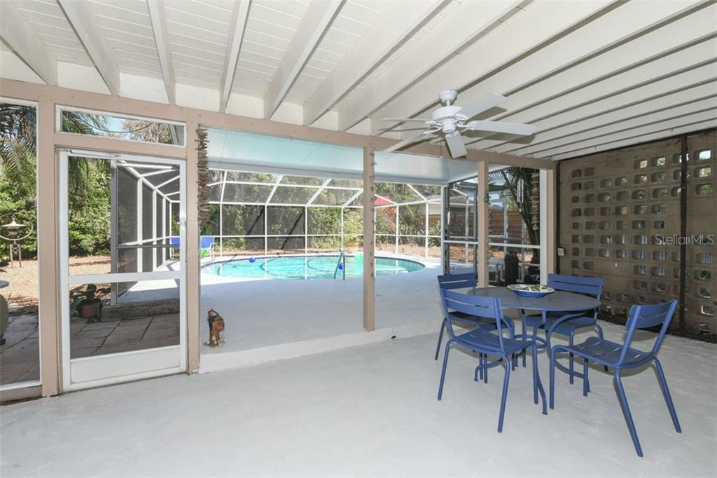 The 24 long screen porch is perfect for outdoor entertaining or peaceful relaxation. - Single Family Home for sale at 7727 Westmoreland Dr, Sarasota, FL 34243 - MLS Number is A4430900