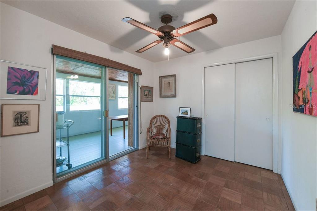 Bedroom 4, although modest in size, is still large enough for a single bed or could be used as an den or study. - Single Family Home for sale at 7727 Westmoreland Dr, Sarasota, FL 34243 - MLS Number is A4430900