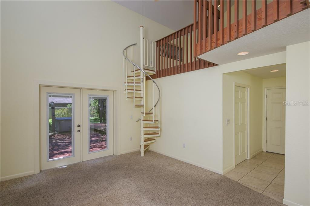 Master bedroom suite w/spiral staircase leading to loft area and extra storage area - Single Family Home for sale at 7611 Alhambra Dr, Bradenton, FL 34209 - MLS Number is A4434753