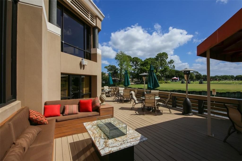 Sit outside on the deck and watch the golfers come in from their round of golf. - Condo for sale at 5602 Sheffield Greene Cir #2, Sarasota, FL 34235 - MLS Number is A4436218