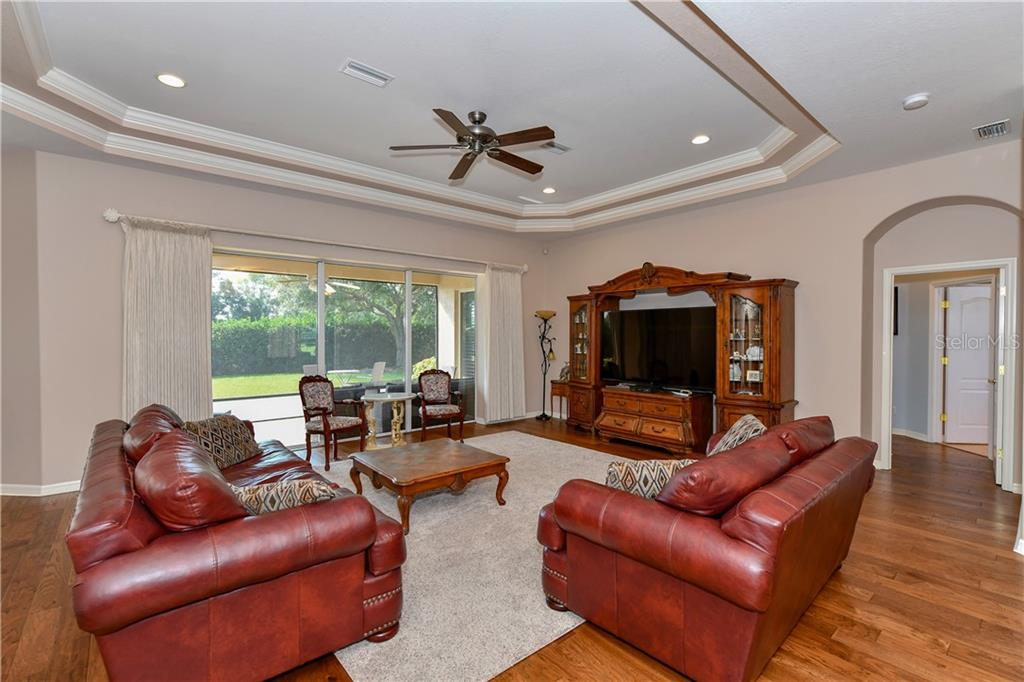 Large Great Room w/wood flooring - Single Family Home for sale at 2745 Harvest Dr, Sarasota, FL 34240 - MLS Number is A4436381
