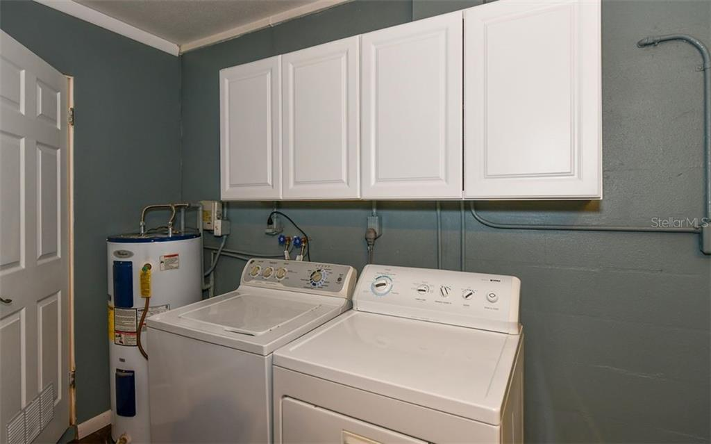 Laundry area in the office/workroom. - Single Family Home for sale at 120 23rd Street Ct Ne, Bradenton, FL 34208 - MLS Number is A4438232