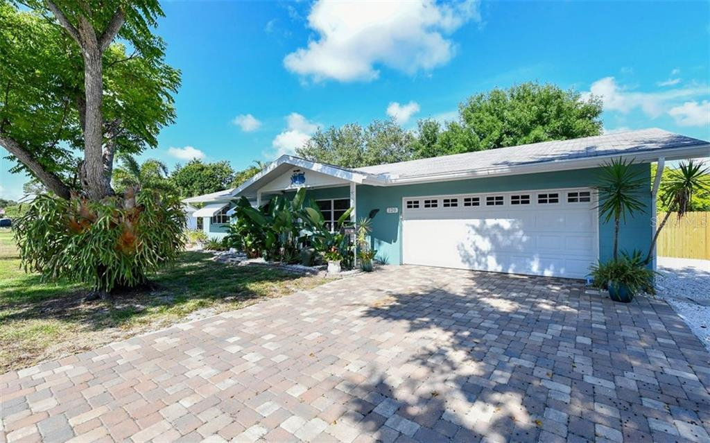 Front view with paver drive, gorgeous staghorn on the tree! - Single Family Home for sale at 120 23rd Street Ct Ne, Bradenton, FL 34208 - MLS Number is A4438232