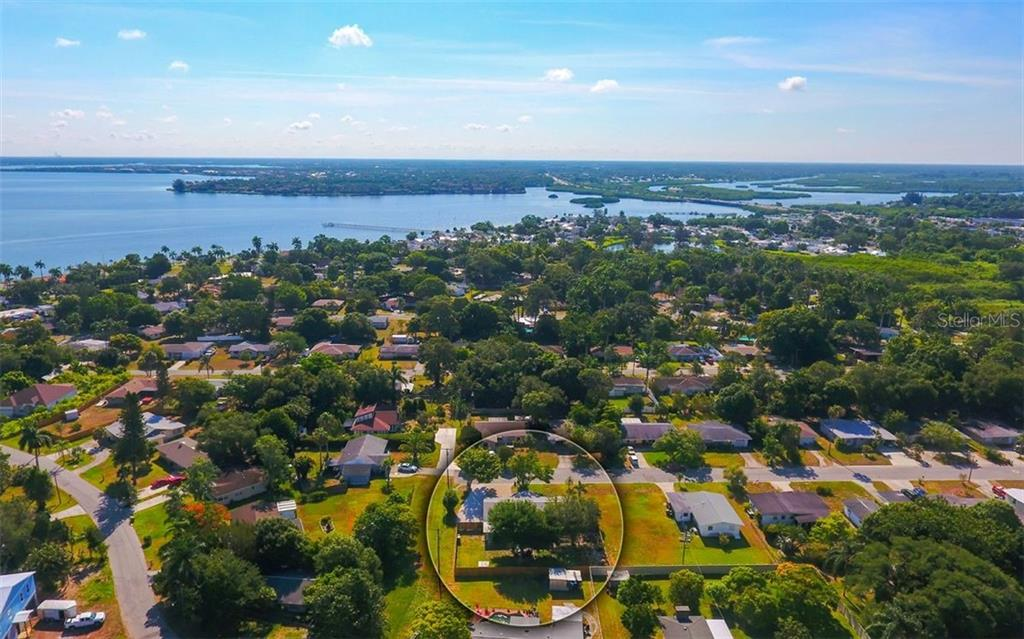 Aerial with view of the Manatee River beyond. - Single Family Home for sale at 120 23rd Street Ct Ne, Bradenton, FL 34208 - MLS Number is A4438232