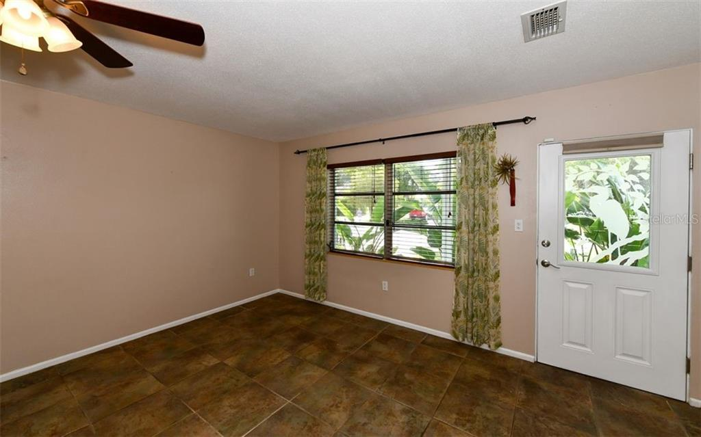 Living room & front door entry. - Single Family Home for sale at 120 23rd Street Ct Ne, Bradenton, FL 34208 - MLS Number is A4438232