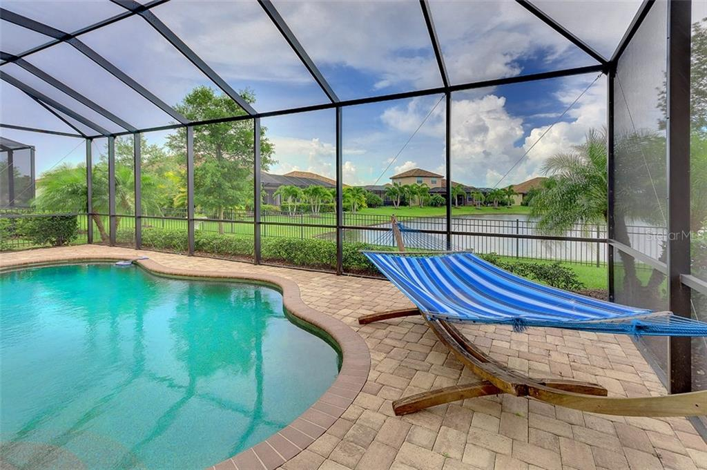 Single Family Home for sale at 13424 Ramblewood Trl, Lakewood Ranch, FL 34211 - MLS Number is A4438591