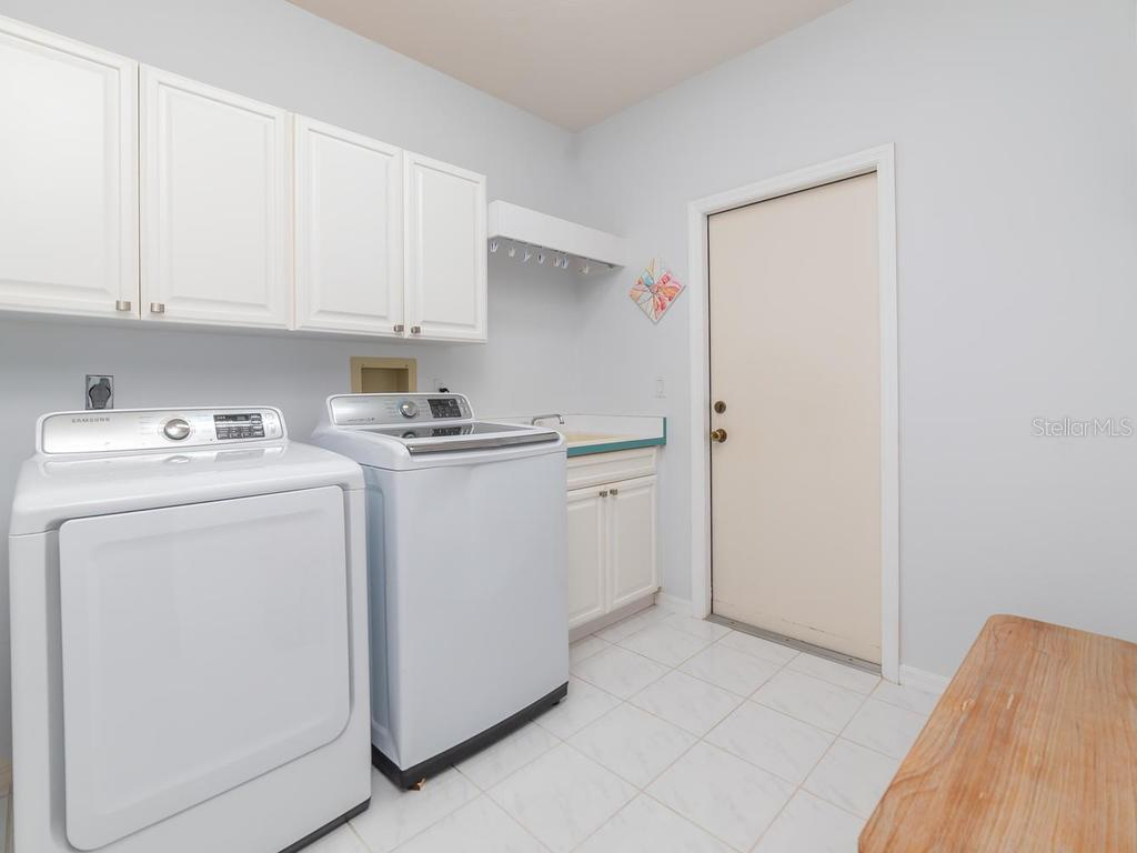 Laundry Room, lots of storage, with door leading into garage. - Single Family Home for sale at 4117 Via Mirada, Sarasota, FL 34238 - MLS Number is A4438764