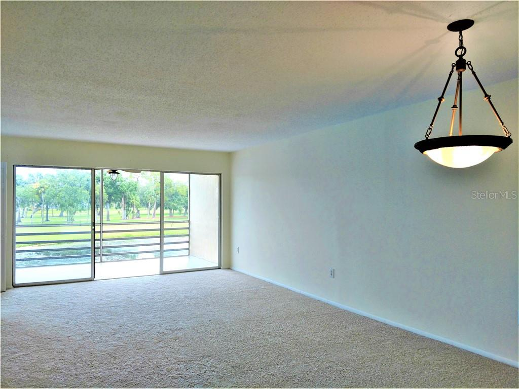 Dinning/ Living Combo w/ view - Condo for sale at 7301 W Country Club Dr N #208, Sarasota, FL 34243 - MLS Number is A4440393