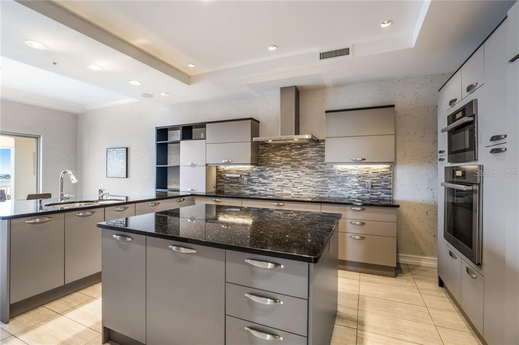 The kitchen was recently updated by Lube and it features Miele appliances and a SubZero refrigerator. - Condo for sale at 1111 Ritz Carlton Dr #1704, Sarasota, FL 34236 - MLS Number is A4442192