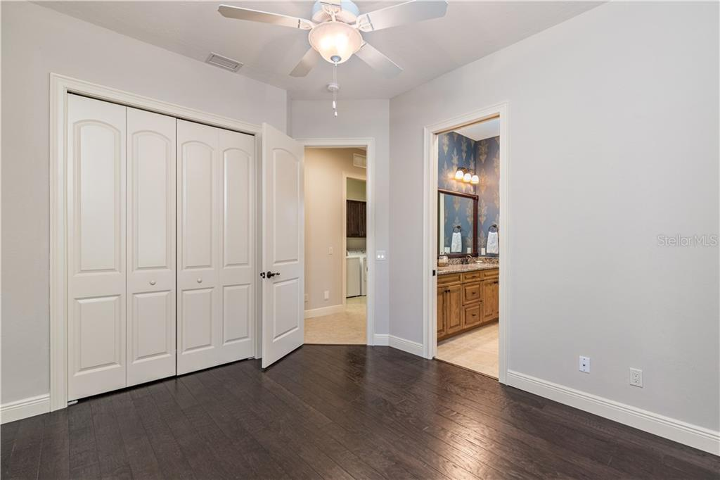 Owners walk in closet - Single Family Home for sale at 14710 Leopard Creek Pl, Lakewood Ranch, FL 34202 - MLS Number is A4442202