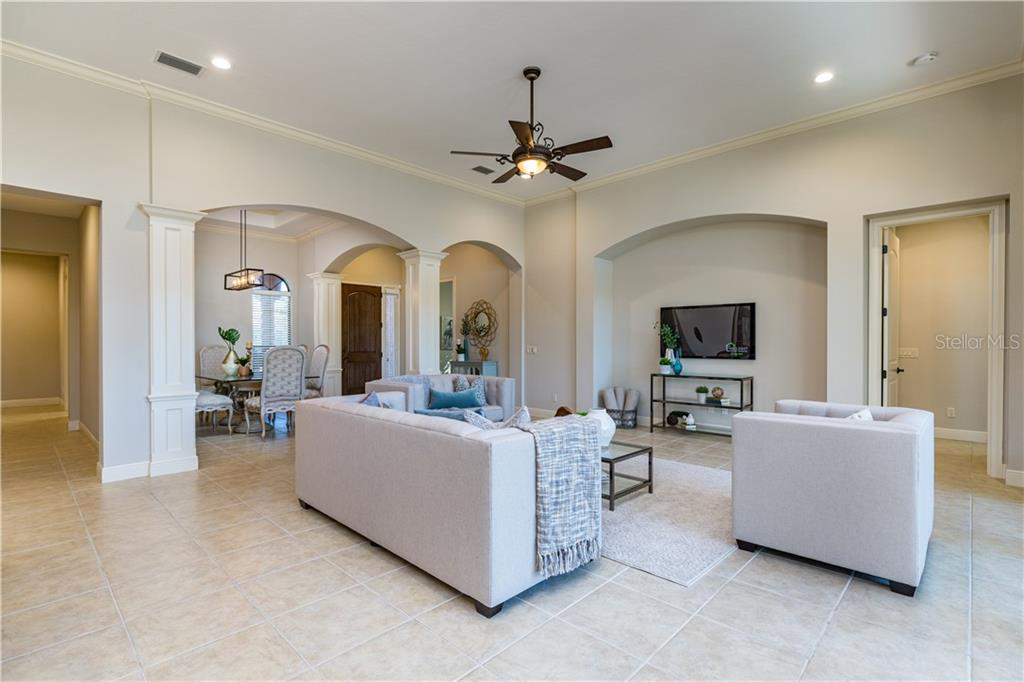 Open concept yet room separated by architectural design - Single Family Home for sale at 14710 Leopard Creek Pl, Lakewood Ranch, FL 34202 - MLS Number is A4442202