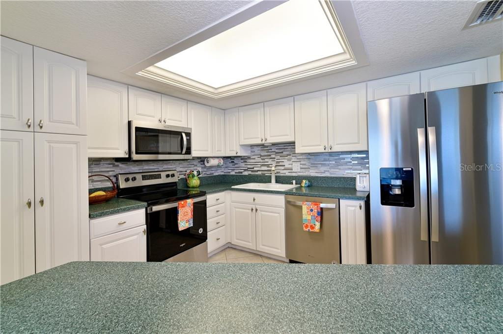Fully equipped kitchen where you will enjoy preparing your favorite meals for family and friends .. - Condo for sale at 4706 Independence Dr, Bradenton, FL 34210 - MLS Number is A4443759
