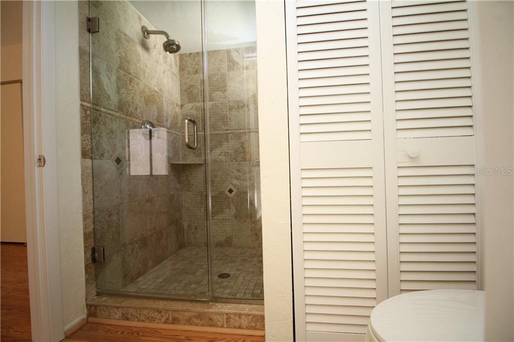 Second Floor Shower Master Bathroom - Custom Tile Glass Door - Townhouse for sale at 4319 Woodmans Chart #130, Sarasota, FL 34235 - MLS Number is A4445530