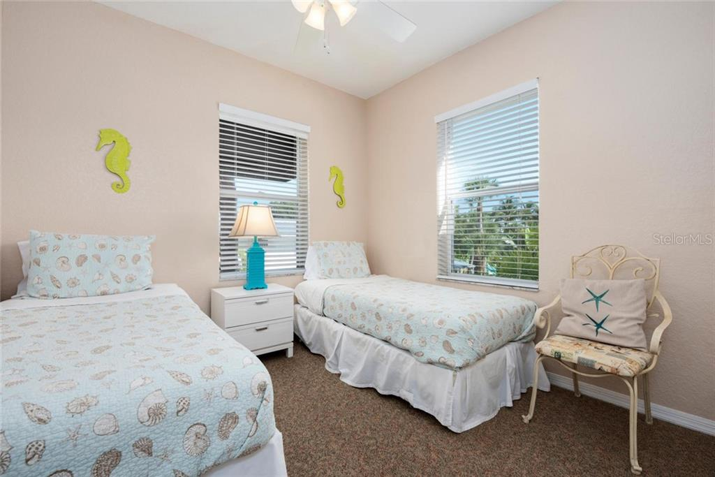 Lion Bedroom. - Single Family Home for sale at 523 Beach Rd, Sarasota, FL 34242 - MLS Number is A4446354