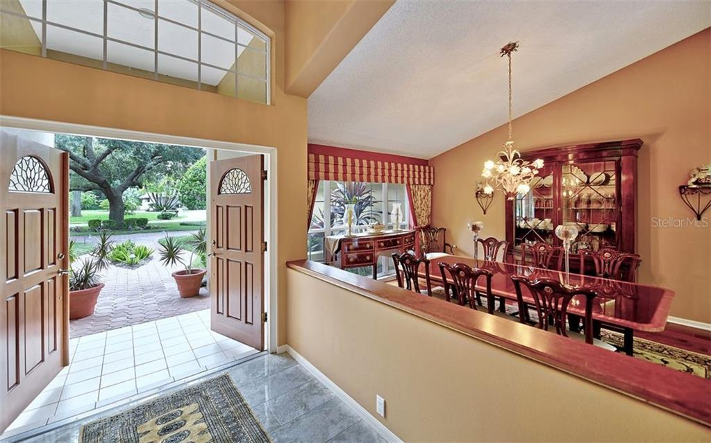 Double door entry into foyer! - Single Family Home for sale at 4839 Windsor Park, Sarasota, FL 34235 - MLS Number is A4449948