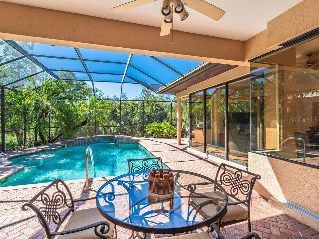 One of two covered lanai areas - Single Family Home for sale at 6826 Turnberry Isle Ct, Lakewood Ranch, FL 34202 - MLS Number is A4450601