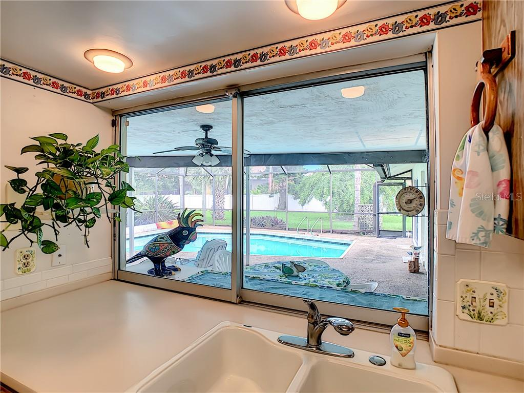 Cheery outlook when you stand at the kitchen sink. - Single Family Home for sale at 7006 18th Ave W, Bradenton, FL 34209 - MLS Number is A4450658