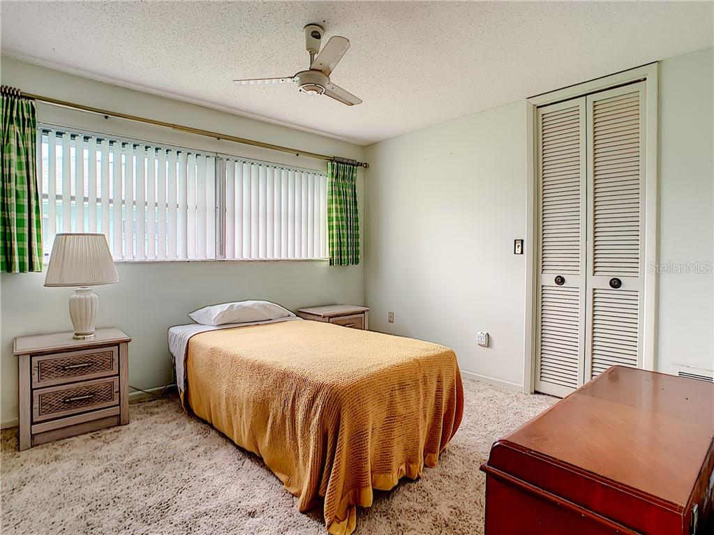Bedroom 2 is 14x10 and has a walk-in closet. - Single Family Home for sale at 7006 18th Ave W, Bradenton, FL 34209 - MLS Number is A4450658