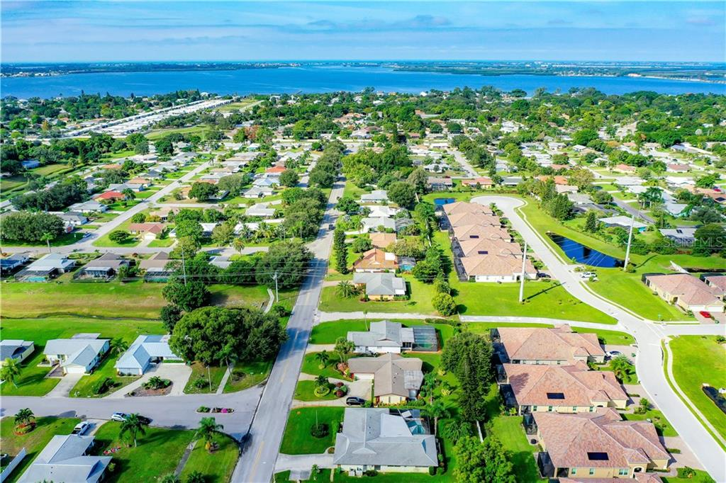 House is bottom center.  Background is Palma Sola Bay w/beaches just beyond. - Single Family Home for sale at 7006 18th Ave W, Bradenton, FL 34209 - MLS Number is A4450658