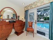 Master Bedroom - Pool and Lanai - Single Family Home for sale at 916 N Casey Key Rd, Osprey, FL 34229 - MLS Number is A4408082