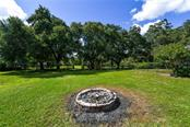 Fire pit for entertaining. - Single Family Home for sale at 2045 Frederick Dr, Venice, FL 34292 - MLS Number is A4416740